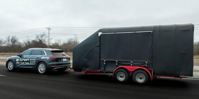 Audi e-Tron exhibits power by towing GM EV1 carrying trailer